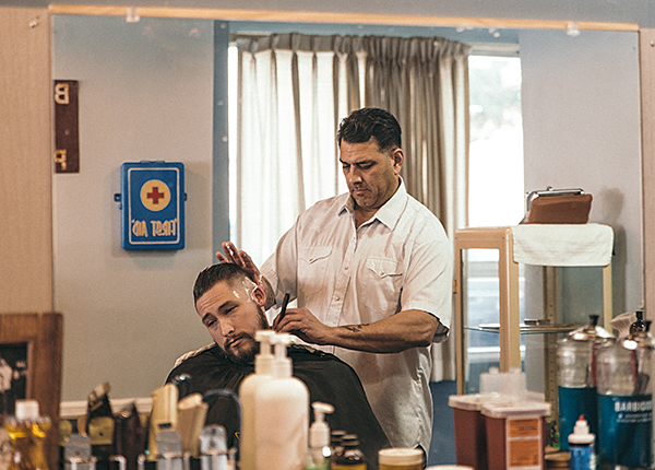 Photo of Jon Vidana cutting hair